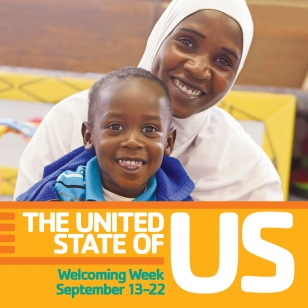 "A woman wearing a headscarf holds her school age son with the text ""The United State of Us"""