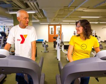 Adults chat while on treadmills