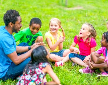 Man entertains group of young children