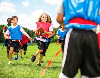Group of children play flag football