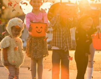 Kids in Halloween costumes at sunset