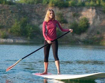 woman paddle boarding