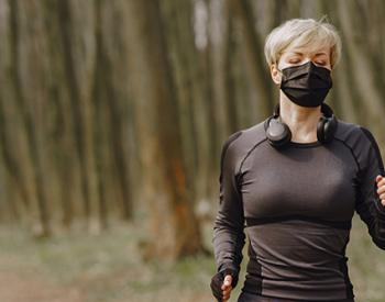 Woman wearing mask and running