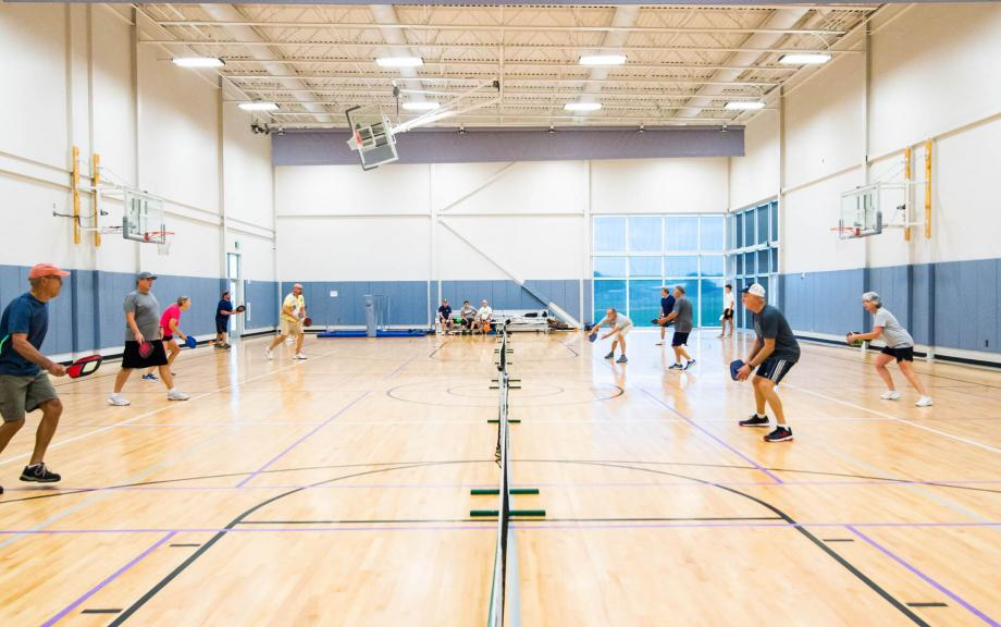 YMCA members play pickleball in gymnasium