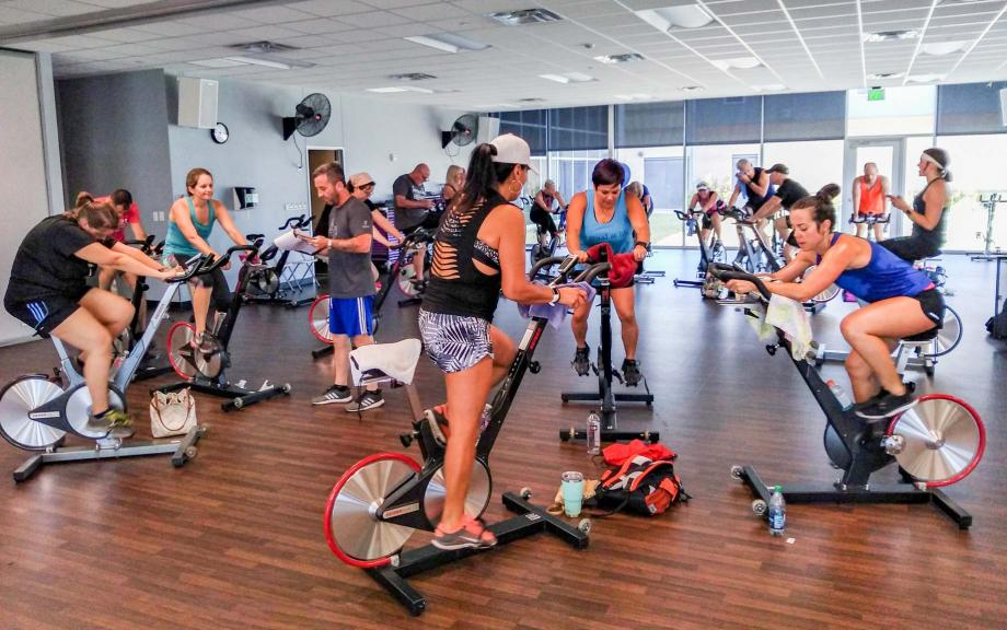 YMCA members participate in spin class
