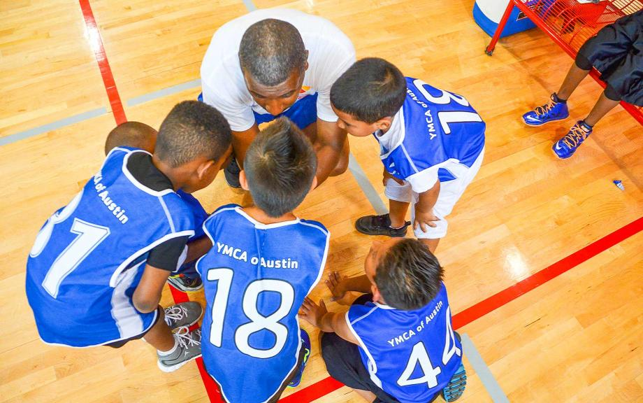 Topdown view of kids basketball huddle