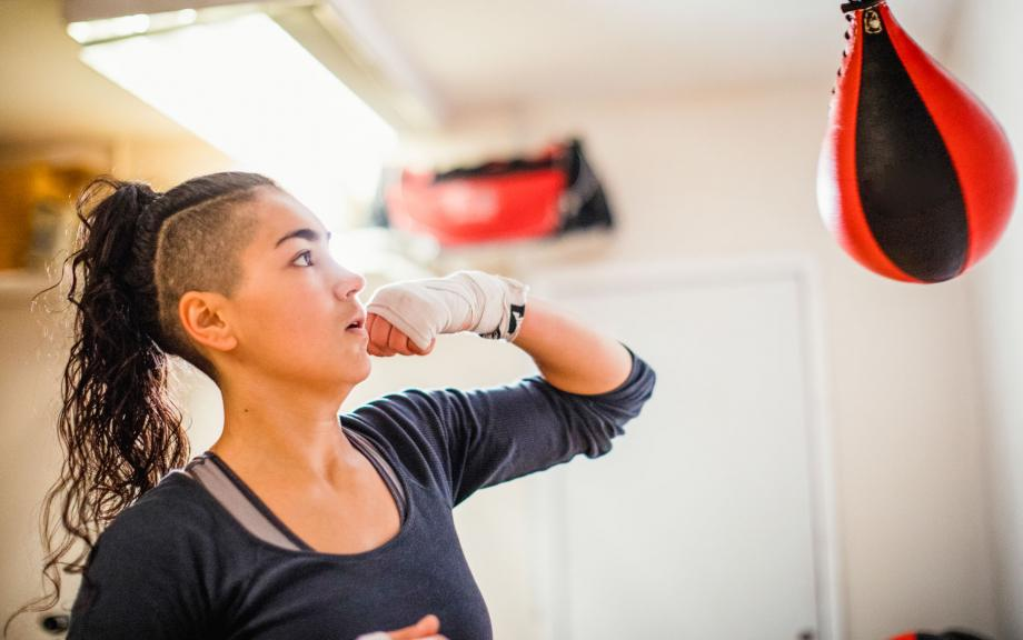 Women works out with punching bag