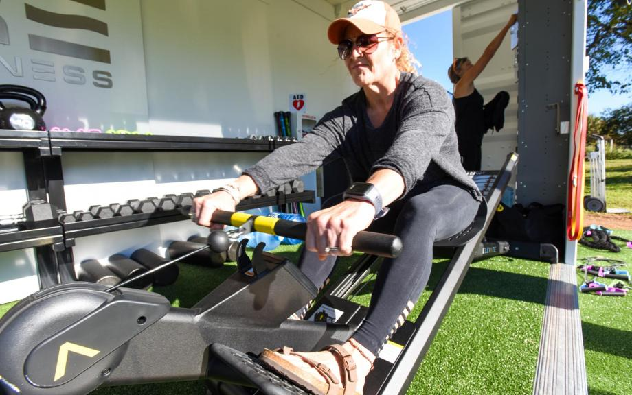 Woman uses rowing exercise machine