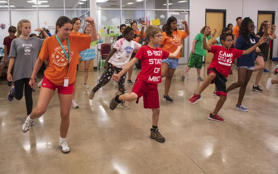 A group of teen campers dancing in a zumba class at the Hays YMCA
